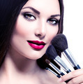 Beauty Woman with Makeup Brushes. Applying Holiday Makeup - PhotoDune Item for Sale