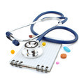 stethoscope and notebook on white - PhotoDune Item for Sale