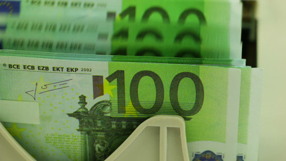 Banknote Counter and Stack of 100 Euro