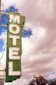 Neon Motel Sign Clear Blue Sky White Billowing Clouds - PhotoDune Item for Sale