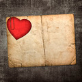 old paperboard card with red paper heart on a dark fabric backgr - PhotoDune Item for Sale