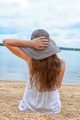 Female in a Beach Hat Gazes out over the Lake - PhotoDune Item for Sale
