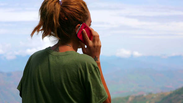 Female Tourist Using Mobile Phone at Mountain 2