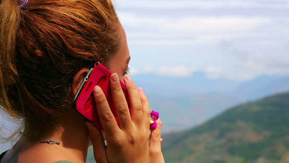 Female Tourist Using Mobile Phone at Mountain 3