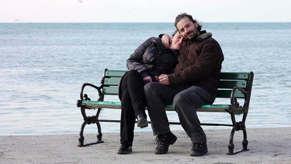 Lovers Hugging At Coast