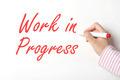Writing work in progress word on whiteboard  - PhotoDune Item for Sale