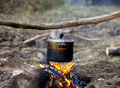 Cooking in sooty cauldron on campfire - PhotoDune Item for Sale