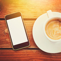 Smart phone and espresso coffee on wooden surface - PhotoDune Item for Sale
