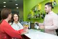 Bartender and smiling women at bar - PhotoDune Item for Sale