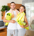 Smiling couple with towels before yoga class - PhotoDune Item for Sale