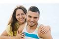 Smiling pair having romantic date on sandy beach - PhotoDune Item for Sale