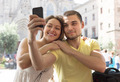 Couple doing selfie at the street - PhotoDune Item for Sale