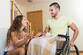 man in wheelchair and girl  having conversation - PhotoDune Item for Sale