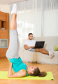 Girl practicing yoga and  boyfriend resting - PhotoDune Item for Sale