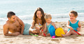 Family of four at the beach - PhotoDune Item for Sale