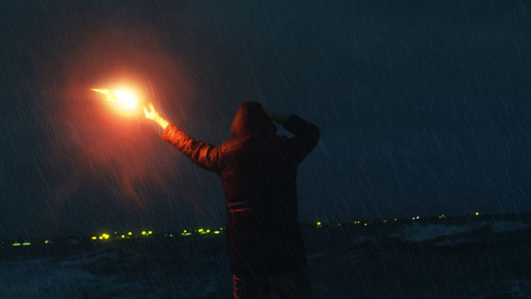 Man Waving with Signal Road Flare for Help 2