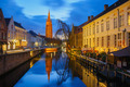 Cityscape with canal Dijver and a Church of Our Lady in Bruges - PhotoDune Item for Sale