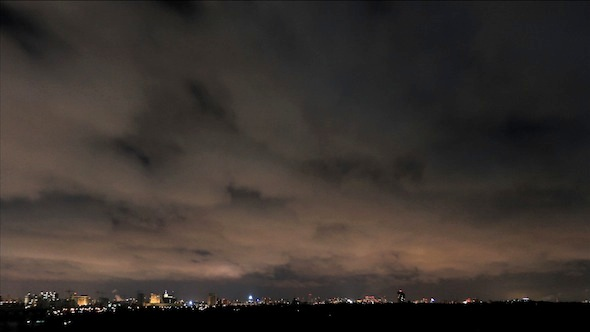Night Sky And Clouds Over The City