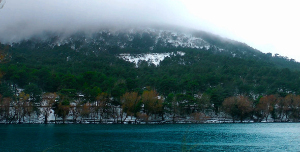 Snow on Mountain and Lake in Winter