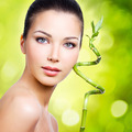 Closeup healthy face of young woman with sprout - PhotoDune Item for Sale