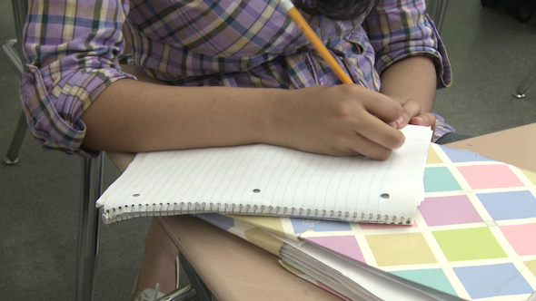 Junior High Students Writing In Class 5 Of 6
