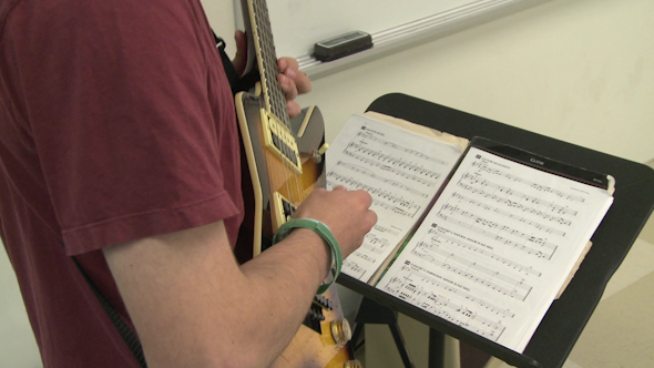 Students Reading Sheet Music In Class 9 Of 9