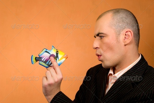 Man and Fish - Stock Photo - Images