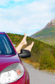 Female feet stick out of car window - PhotoDune Item for Sale