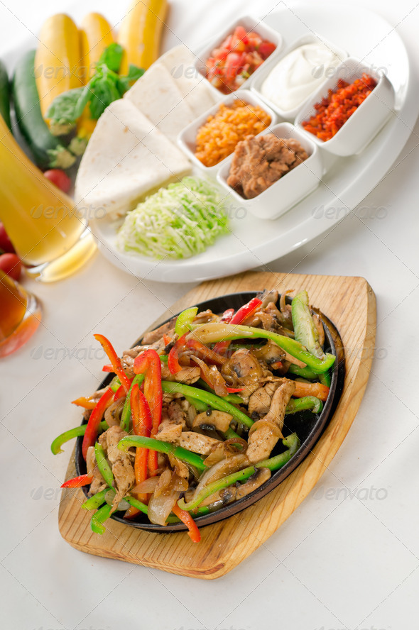 original fajita sizzling hot  on iron plate - Stock Photo - Images