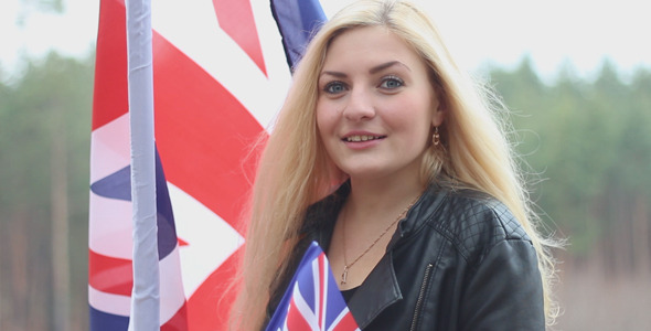 Girl Talking on the Background of the British Flag