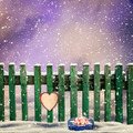 snow-covered wooden fence with a paper heart and a gift  - PhotoDune Item for Sale