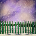 snowy old green wooden fence and falling snow - PhotoDune Item for Sale