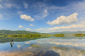 Tropical lake under blue cloudy sky. - PhotoDune Item for Sale