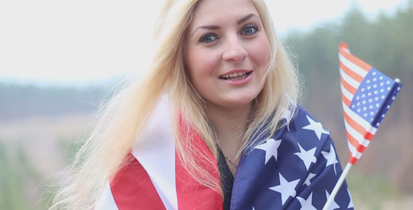 VideoHive Girl With a American Flag Talking 10094447