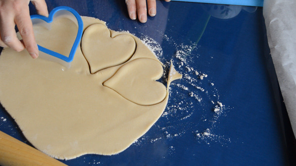 VideoHive Woman Makes Heart Shapes out of Dough 10096619