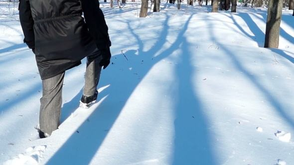 Man Walking in Deep Snow