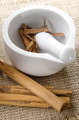 mortar and pestle with cinnamon on jute - PhotoDune Item for Sale