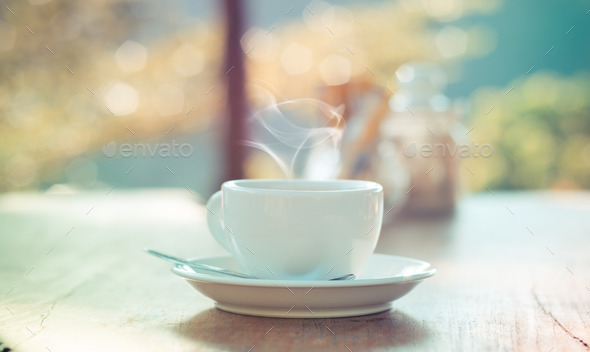 Outdoor Coffee cup with natural bokeh - vintage effect process s
