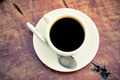 Black coffee cup on wood table top view - PhotoDune Item for Sale