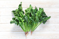 Fresh spinach on wood background - PhotoDune Item for Sale