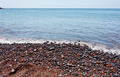 Red pebbles of the typical red beach of Santorini - PhotoDune Item for Sale