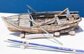 Old damaged rowing boat withpaddles and rope - PhotoDune Item for Sale