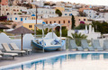 View of Fira town from a resort with swimming pool. - PhotoDune Item for Sale