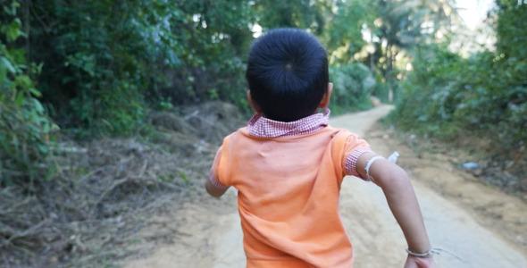 VideoHive Poor Kid Running On Dirt Road 10105985
