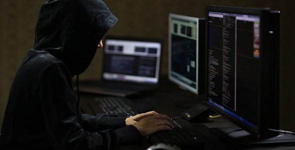 VideoHive Hacker in Hood Typing on Keyboard 10106102