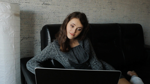 VideoHive Young Woman Working On A Laptop At Home 10108764