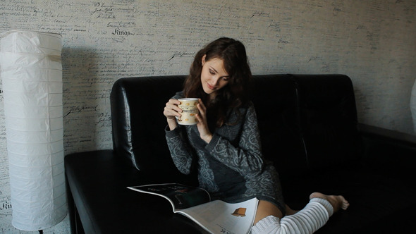 VideoHive Woman Reading Magazine And Drinking Coffee 10108812