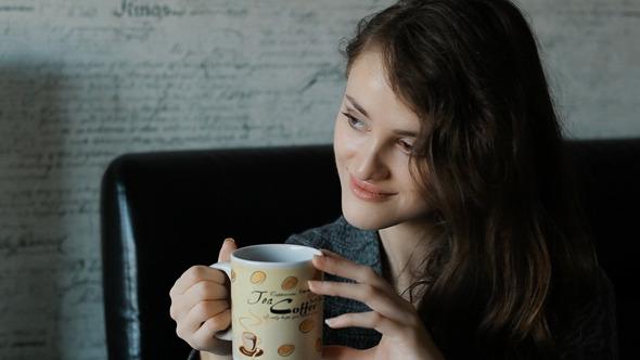 VideoHive Beautiful Woman In Drinking Coffee 10108844