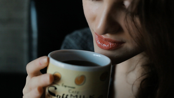 VideoHive Woman In Drinking Coffee 10111781