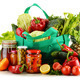 Green shopping bag with groceries isolated on white - PhotoDune Item for Sale